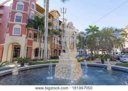 Naples Fl USA - March 18 2017: Neptune statue and fountain in Naples downtown. Florida United States