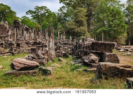 Ruined walls of the Prasat Bayon the central temple of Angkor Thom Complex, Siem Reap, Cambodia. Ancient Khmer architecture and famous Cambodian landmark World Heritage.