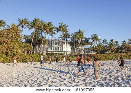 Naples Fl USA - March 20 2017: Young people playing volleyball on the beach in Naples. Florida United States