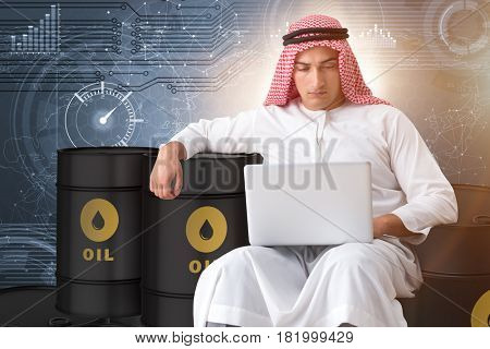 Arab businessman trading crude oil on laptop