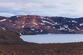 Icelandic giant volcano Askja with two crater lakes, turquoise with warm geothermal water, Iceland poster