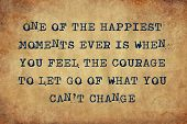 Inspiring motivation quote of one of the happiest moments ever is when you feel the courage to let go of what you can't change with typewriter text. Distressed Old Paper with Typing image. poster