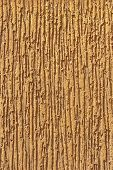 Fragment of light brown ornamental wall stucco covering poster