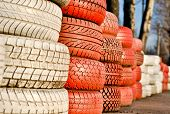 racetrack fence of white and red of old tires poster
