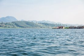 View of Song Karia Riverside including Mountain Range and Rafts Village in Kanchanaburi Western of Thailand