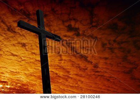 Крест силуэт с заходом солнца как фон