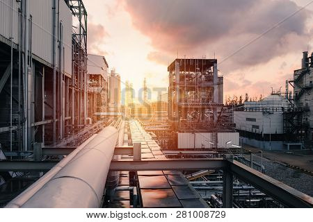 Pipeline And Pipe Rack Of Industrial Plant With Sunset Sky Background, Manufacturing Of Petrochemica
