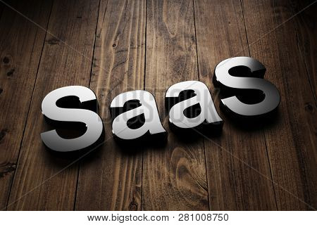 SaaS, or Software as a Service, sign highlighted on wooden boards conceptual of software delivery and licensing. 3d Rendering