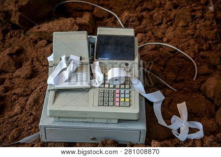 Old Cash Register With Buttons And Display. Cash Register Tape On Old Cash Register. Cash Register O
