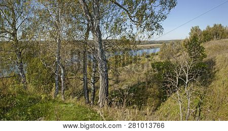 Panorama Of Summer Forest, River And Sky.