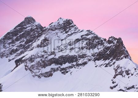 Snowy Summits Of Mount Jungfrau In The Bernese Alps Against The Backdrop Of Sunset Sky In The Pastel