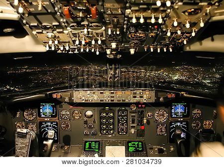 Cockpit Of A Passenger Plane. View From The Cockpit During The Flight Of A Passenger Aircraft.