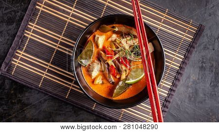 Concept Of Asian Cuisine. Thai Soup Tom Yam Of Chicken Broth And Coconut Milk, Mushrooms, Chicken, C