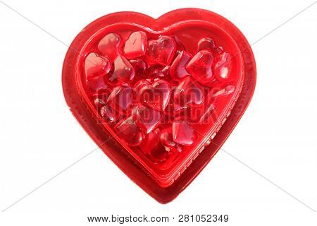 Valentines Day. Valentines Day glass red hearts in a red valentines day heart shaped gift box. isolated on white. room for text.