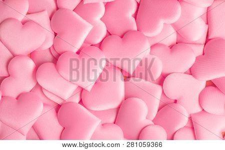 Valentine's Day hearts Background. Holiday Abstract Valentine Background with pink satin Heart. Hearts top view backdrop. Love concept, wedding. St. Valentine's Day. Flatlay