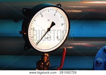 Close-up Of The Pressure Gauge On The Background Of Pipes. The Gauge Arrow Shows Zero. No Pressure I