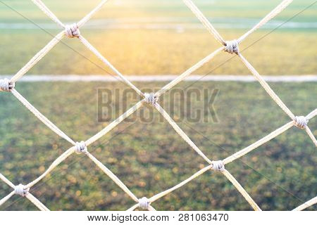 Behind View Of Green Soccer Field.beautiful Artificial Grass On The Stadium.abstract Football Turf G