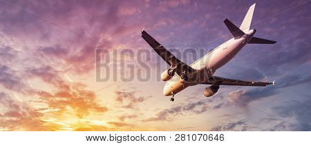 Modern Airplane Against A Sunny Colorful Sky