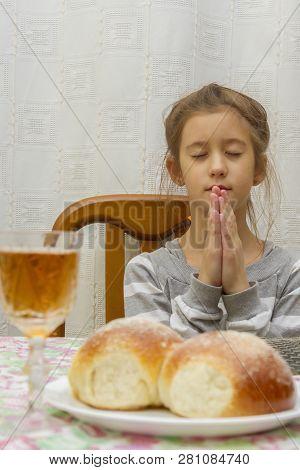 Child Prays At Shabbat. Little Jewish Sabbath. Jewish Child At The Sabbath Table. Vertical Photo