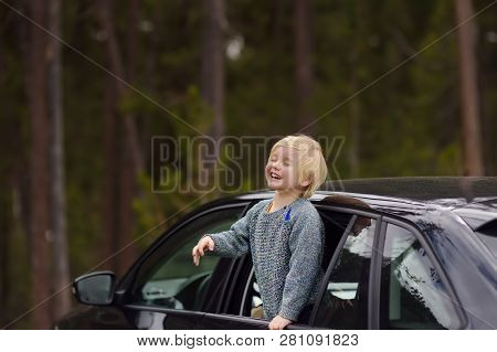 Cute Little Boy Ready For A Roadtrip Or Travel. Family Car Travel With Kids. Child Transportation Sa
