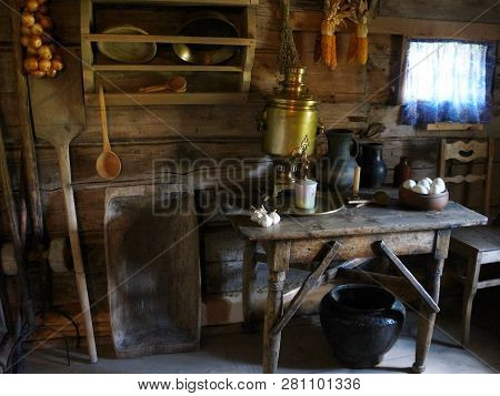 Old Farmhouse Kitchen Interior, Old Country House, Fireplace, Vintage Table. Ancient Kitchen Interio