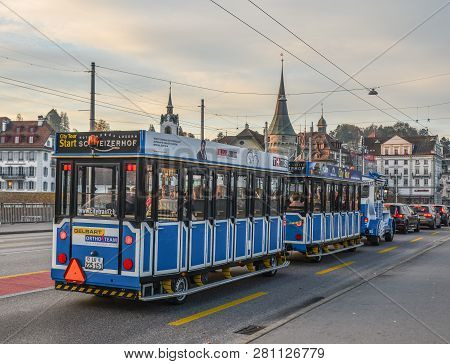 Lucerne, Switzerland - Oct 23,2018. City Tour Shuttle Train Running At Downtown. The Popular Blue Tr