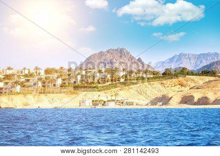 Dessert Coast Of Sharm El Sheikh, Egypt. Blue Sky With Clouds