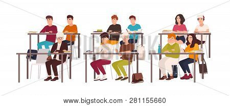 Group Of Pupils Sitting At Desks In Classroom, Demonstrating Good Behavior And Attentively Listening