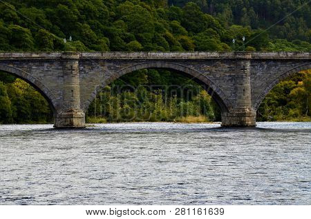 A View Of The Old Stone Bridge Over The River Tay At Dunkeld