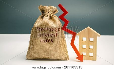 Bag With The Money And The Word Mortgage Interest Rates And Arrow To Down And House. Low Interest In