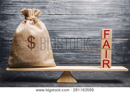 Money Bag And Wooden Blocks With The Word Fair. Balance. Fair Value Pricing, Money Debt. Fair Deal.