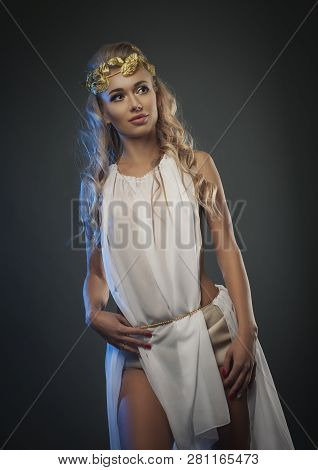 Goddess Young Woman On Dark Studio Shot