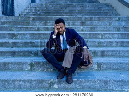 Sad Business Man Suffering From Depression In Total Despair Hopeless And Frustrated In City Stairs