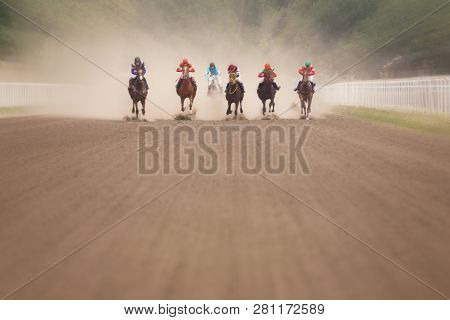 Jockeys During Horse Races On His Horses At Line Going To Finish.