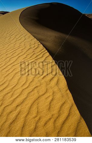 Winding Road on the desert, Djanet, Bordj El Haoues, Sahara, Algeria, Africa poster