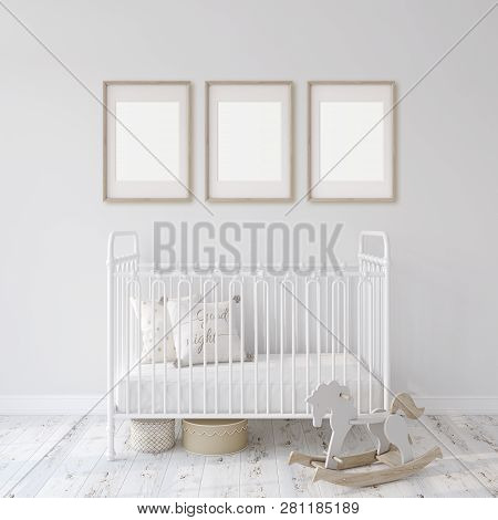 Farmhouse Nursery. White Metal Crib Near White Wall. Three Wooden Frames On The Wall. Interior And F