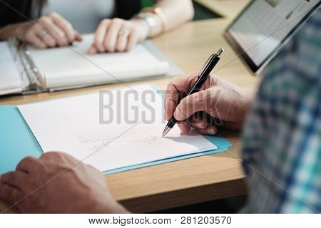 Manager Working As Banking Broker With Old Man Signing Contract
