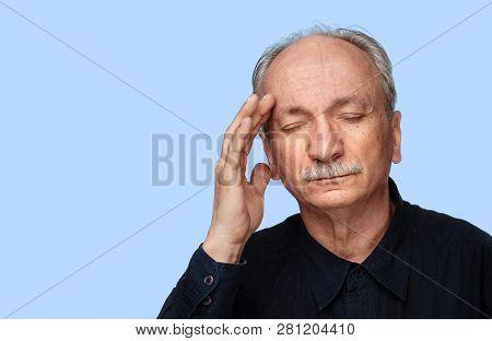 Senior Man Suffering From Headache.
