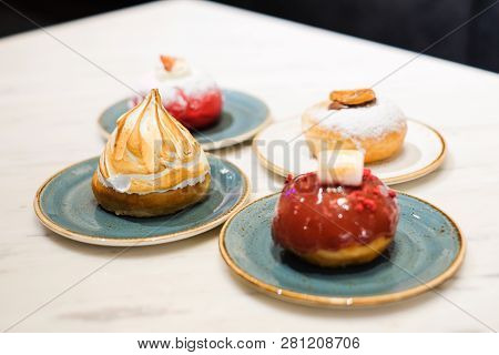 Set Of Dessert Consist Of Various Toppings Donuts (fried Cake In Shape Of A Ball Or Ring) For Backgr