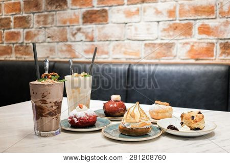 Set Of Dessert Consist Of Various Toppings Donuts (fried Cake In Shape Of A Ball Or Ring) With Choco