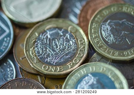 Close Up Of Fractional Currency Coins Of Pound Sterling Such As Ten Pence And One Pound . Saving And