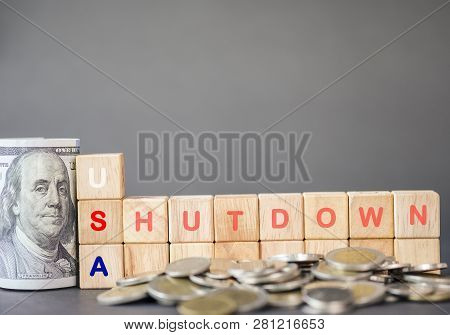 Usa Shutdown Wording On Wooden Cubes And Us Dollar Banknote And Coins On Black Background. United St