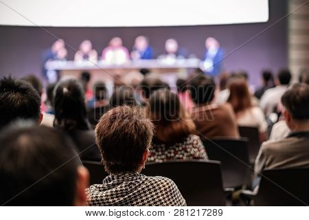 Rear View Of Audience In The Conference Hall Or Seminar Meeting Which Have Speakers Are Brainstormin