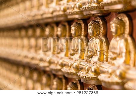Wall In Temple Made By Thousand Of Small Golden Buddha Statue At Chinese Temple Named The Wat Borom