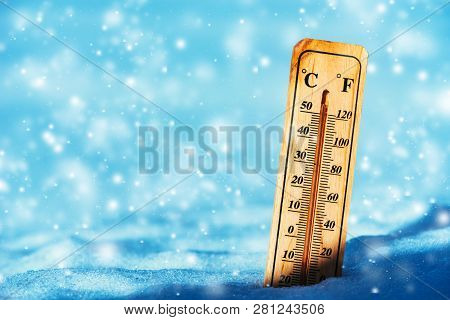 Cold Temperature Below Zero On Thermometer In Snow During Winter Season