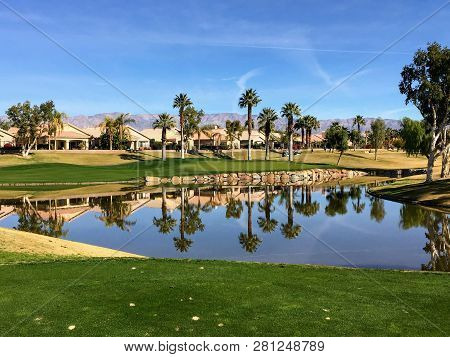 A Beautiful View From The Tee Box Of A Difficult Par 3 That Requires A Shot Over The Water Onto An I