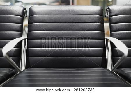 black leather chair in airport terminal