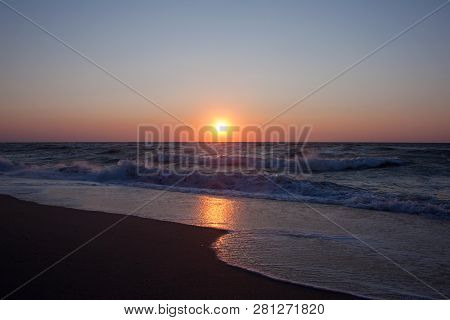 Blue Sunrise Over The Sea On Colorful Background. Dramatic Scene. Natural Landscape. Ocean View Beac