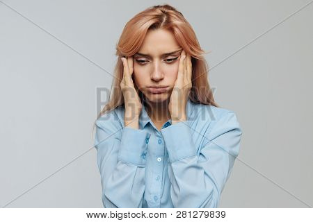 Very Tired Young Woman In Blue Shirt Wants To Sleep At Work Or University, Opening Her Eyes With The