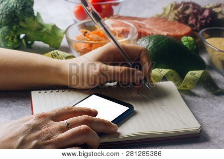 Healthy Eating, Dieting, Calories Counting And Weigh Loss Concept. Woman Using Calorie Counter Appli